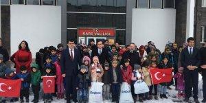 Kars'ta göçmen çocuklara kışlık yardım yapıldı