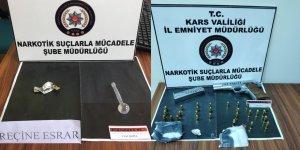 Kars'ta uyuşturucu ve ruhsatsız tabanca ele geçirildi